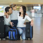 buy currency before you fly family luggage travel airport