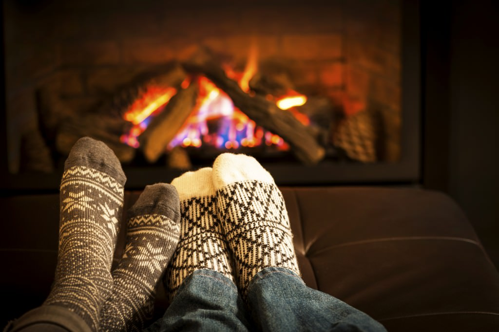 couple_home_fireplace_warm