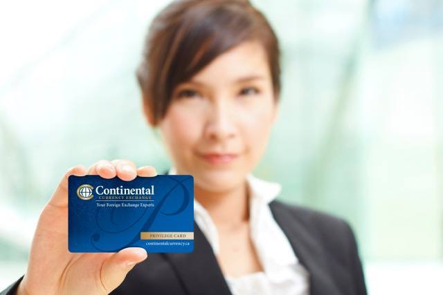 businesswoman_holding_privilege_card_continental_currency_exchange
