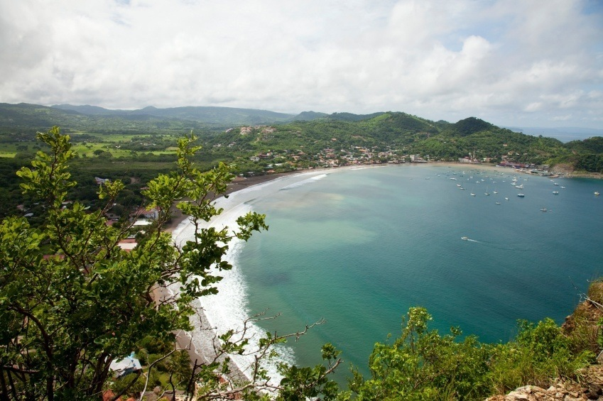 white sand beach and town seen from above in nicaragua
