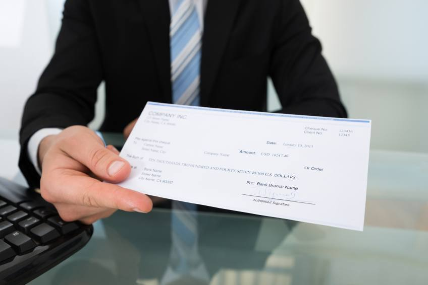 man holding check money keyboard