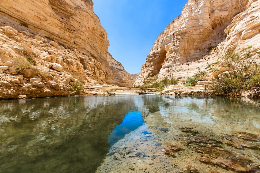 valley rocky water gorge sun reflection