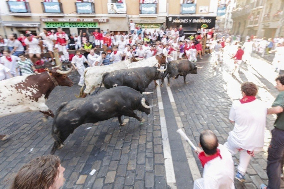 spanish festivals running bulls pamplona red white