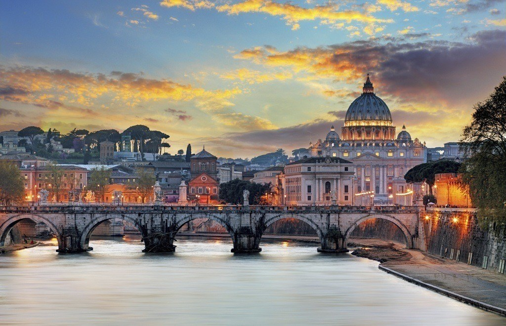 where to travel in italy vatican tiber bridge rome italy sunset