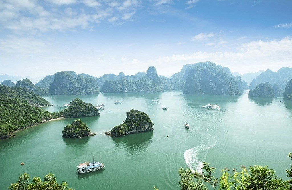 where to travel in vietnam ha long bay ships water islands