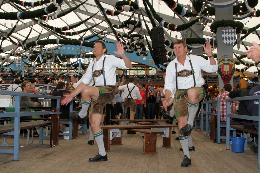 oktoberfest germany men dancing lederhosen beer traditional culture
