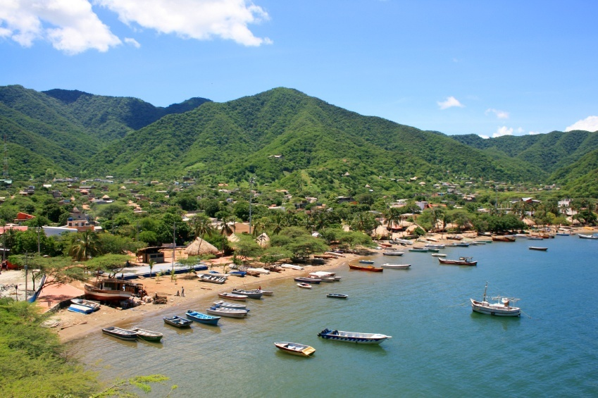 colombia beach boats mountains south america