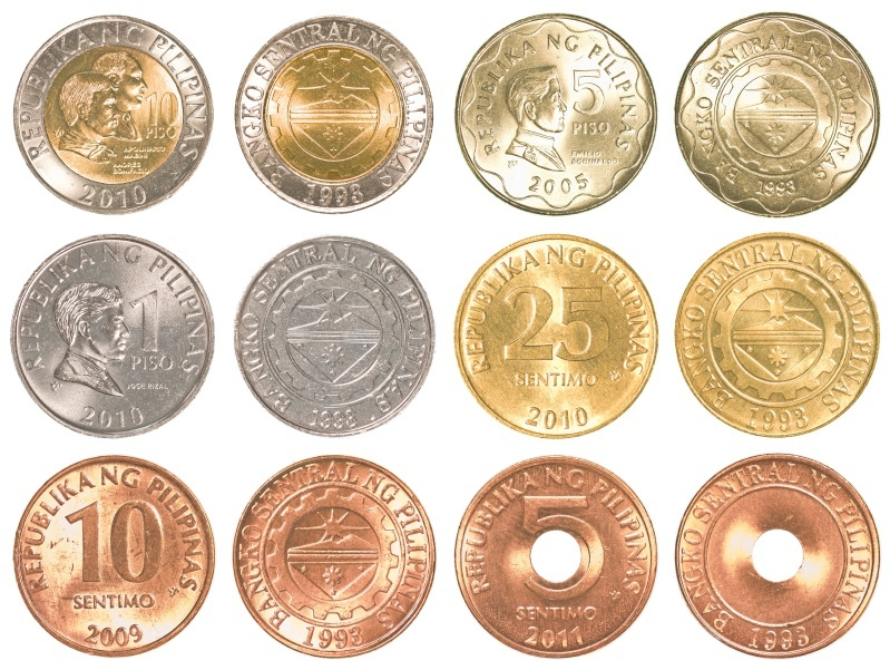 philippines peso coins sorted white background