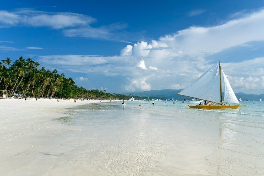 boracay white sand beach philippines boat people