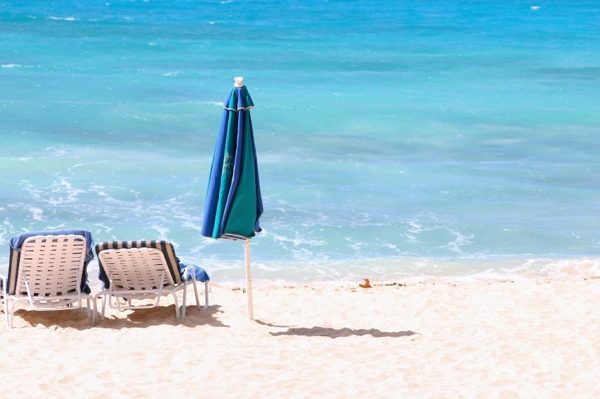barbados chairs white sand beach umbrella