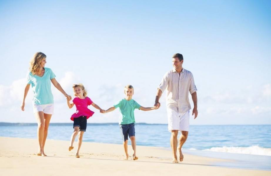 spring break vacations for families family beach holding hands