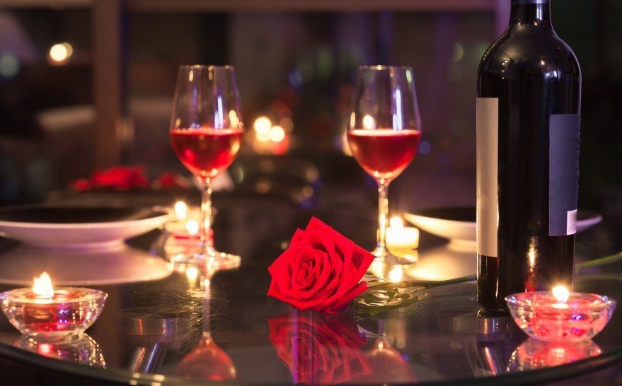 romantic dinner valentine's day wine glasses candle