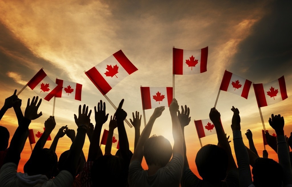 woman on the next banknote crowd waving flags canada