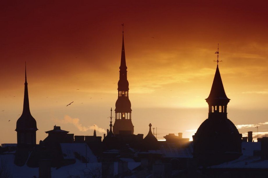 visit latvia travel guide spires sunset tower church shadow