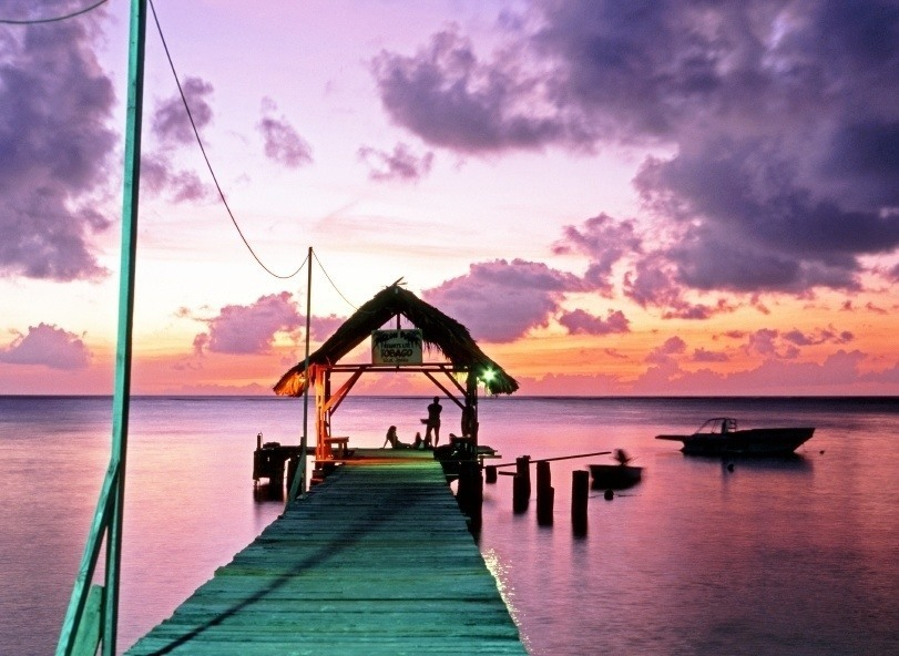 tobago pigeon point pier hut sunset caribbean boat