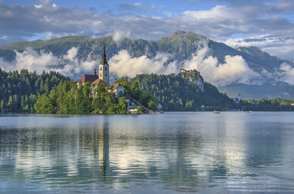 slovenia bled island church lake slovenia clouds