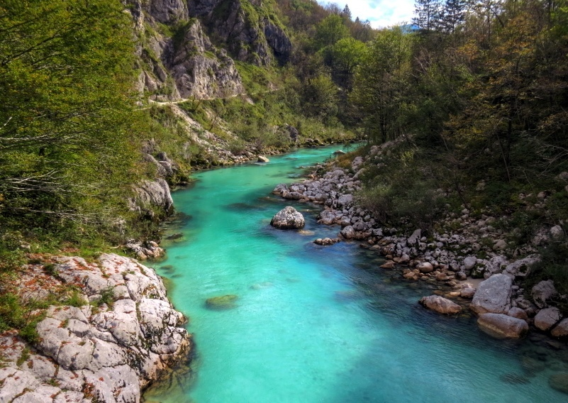 soca river valley blue water rocks forest nature landscape slovenia