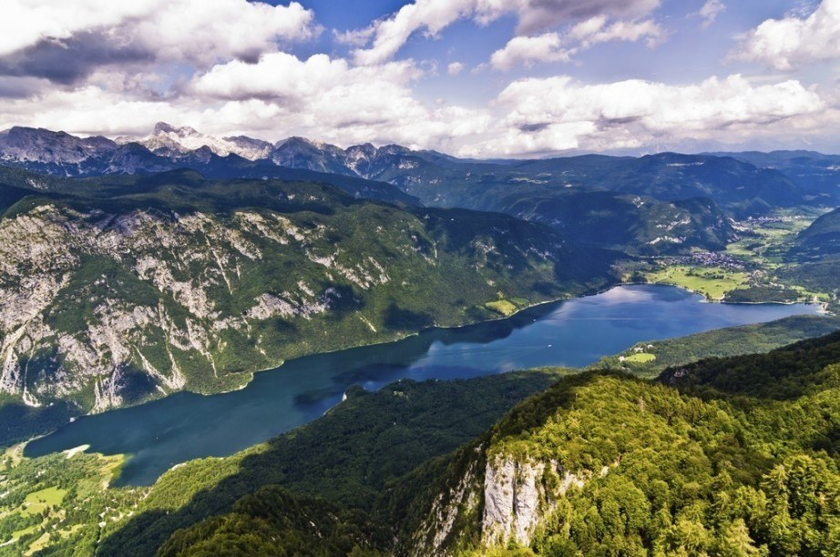 visit slovenia julian alps bohinj lake mountains clouds landscape europe