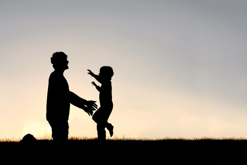 father son hug silhouette outside light shadow