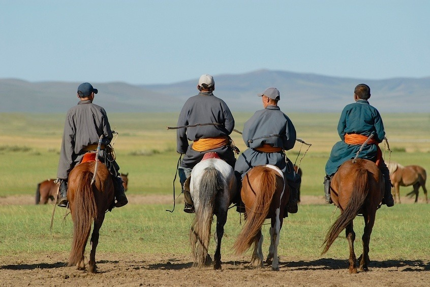 mongolia horseback horse riders four men steppe