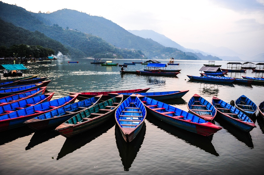 pokhara nepal lake boats blue row mountains city