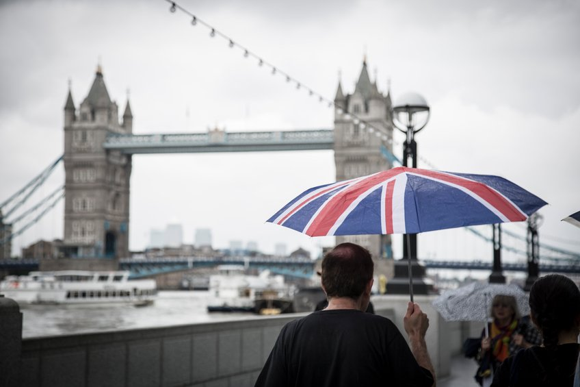 britain tower bridge man umbrella union jack