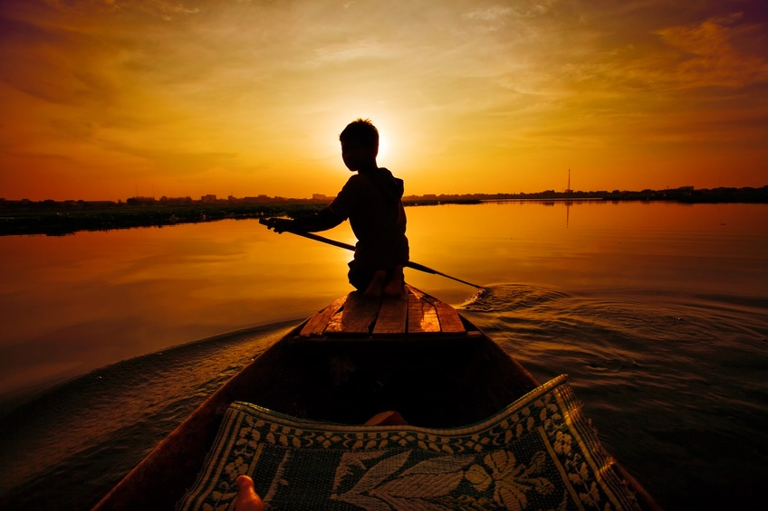 cambodia boat man rowing sunset
