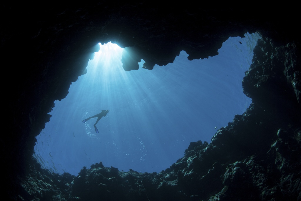 palau travel diving scuba light cave underwater