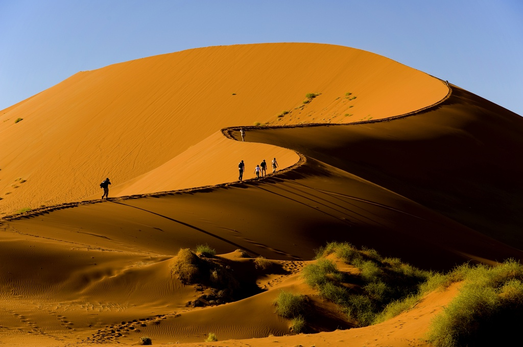 sand dunes desert namibia people walking big