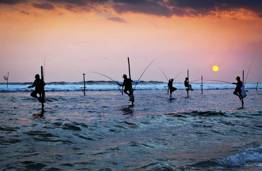 sri lanka tourism travel galle stilts fishing fishermen sunset