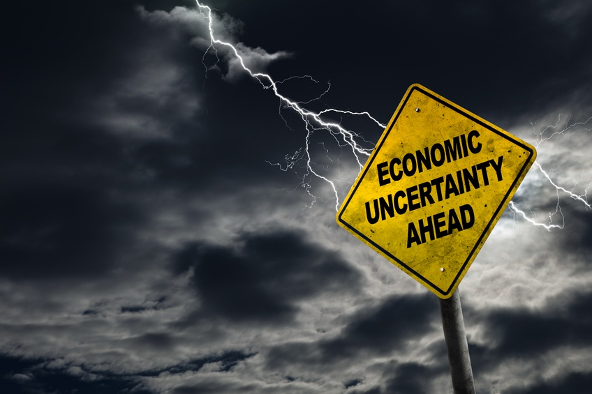 economic uncertainty sign road storm lightning
