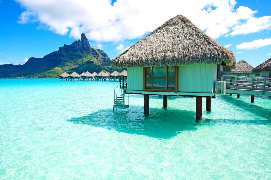 french polynesia travel bora bora bungalow water ocean mountain hut house