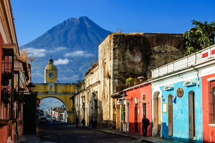 antigua guatemala city volcano colonial architecture arch street