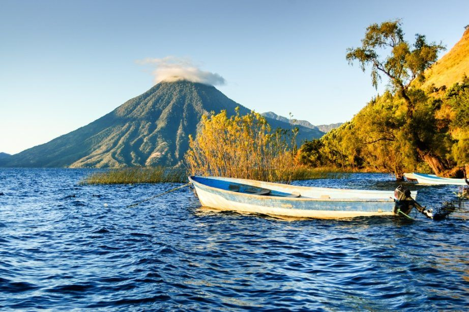 guatemala travel atitlan lake boat volcano water