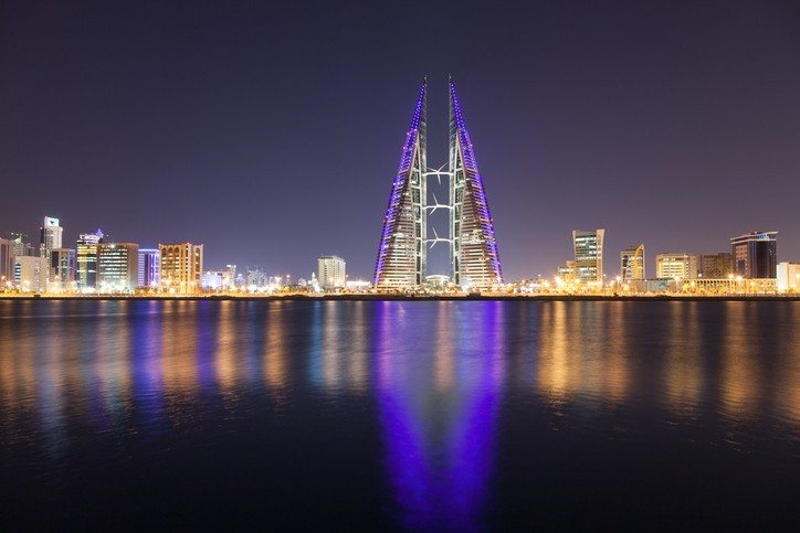 manama bahrain city night tower building modern harbor