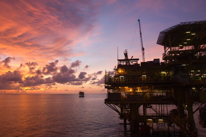brunei oil rig sunset ocean sea petroleum