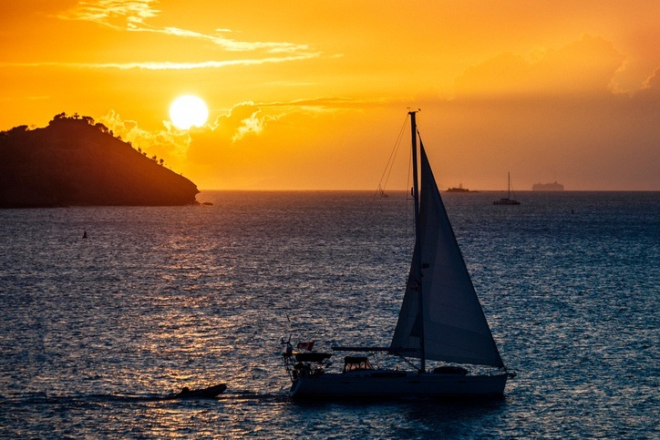 antigua barbuda boat sea caribbean sunset water
