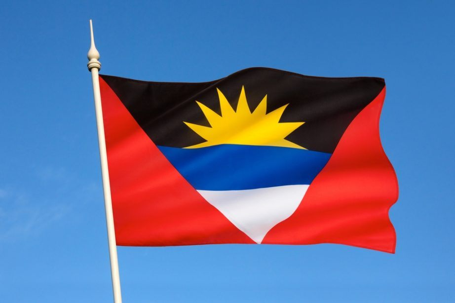 antigua and barbuda flag red sun yellow blue white waving