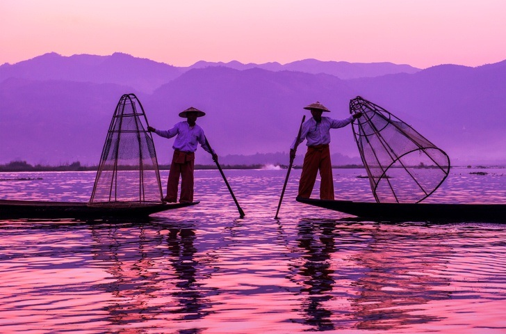 myanmar inle lake fisherman sunset mountains tranquil water
