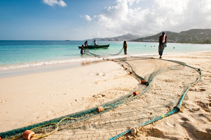 fishing grenada beach boat men net