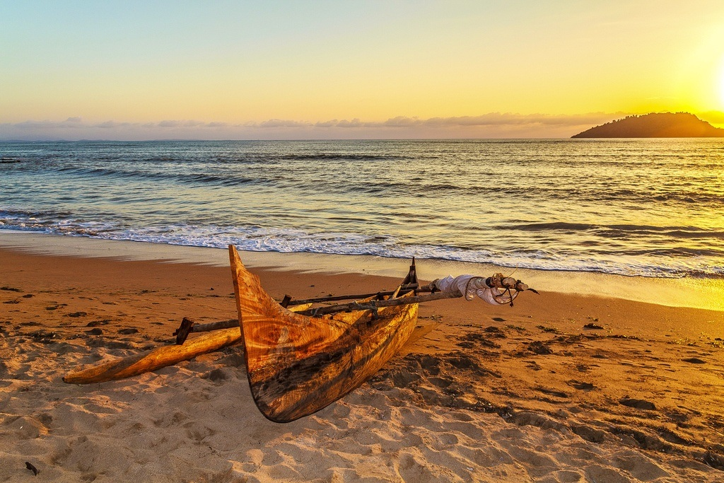 madagascar travel nosy be beach canoe sunset ocean sand