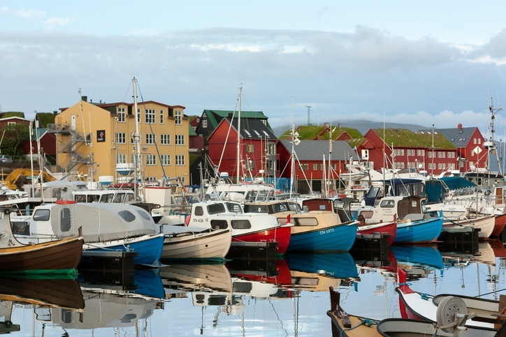 torshavn faroe harbor boats water ocean colored houses city