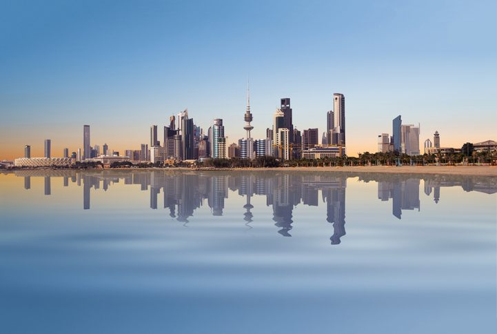 kuwait city skyline bay water reflection