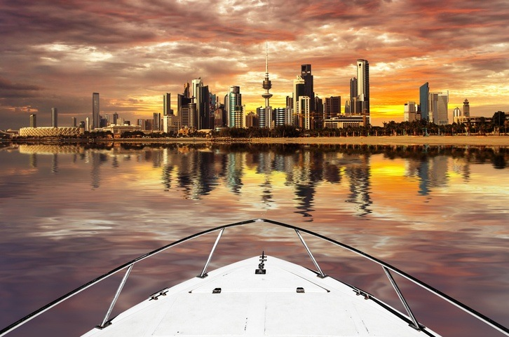 kuwait city skyline boat water sunset