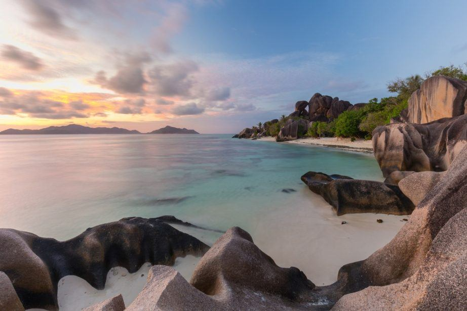 where to travel in seychelles beach la digue sunset sand ocean
