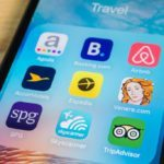 best travel apps iPhone screen phone touch