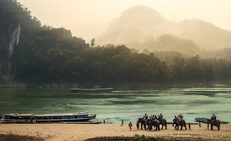 laos landscape mountains luang prabang water people boat