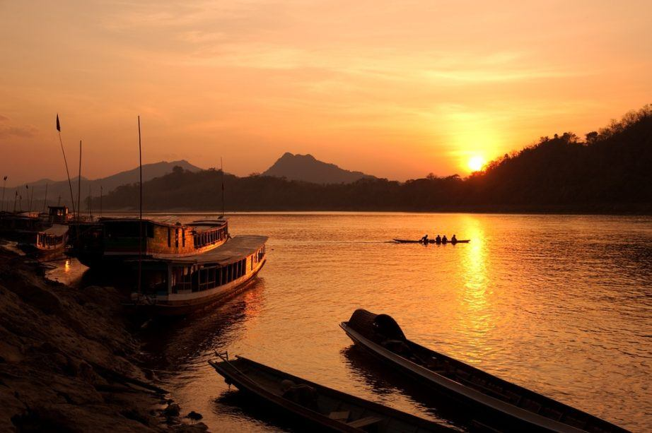 laos travel mekong river sunset boat