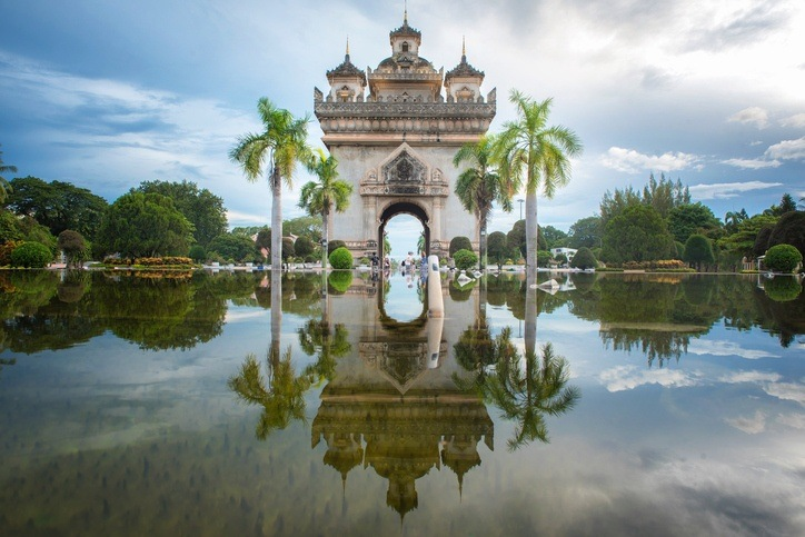 vientiane city architecture laos water reflection arch