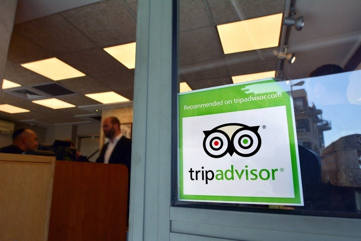 tripadvisor building travel man desk